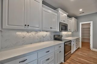 Wall of Cabinets lead to Walk In Pantry that is accessible from Mud Room.