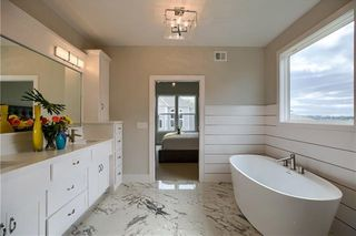 The New Haven 1.5 Story. Master Bathroom. Pictures are of Previous Model, Not Actual Home. Pictures May Feature Upgrades. Please Contact Listing Agent for Stage of Construction, Upgrades, and Available Buyer Selections.