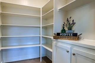 Walk In Pantry. Pictures are of Model and May Feature Upgrades. Not Actual Home.
