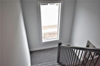 The Durham - 2 Story. Stairwell. Pictures are of Previous Spec, Not Actual Home. Pictures May Feature Upgrades. Please Contact Listing Agent for Stage of Construction, Upgrades, and Available Buyer Selections.