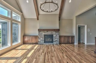 The Sonoma Reverse - Pictures of Actual Home - View from Entry Way into Great Room with Vaulted Beamed Ceiling, Stone Fireplace and Built-in Cabinets