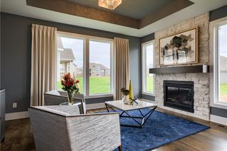 The New Haven 1.5 Story. Hearth Room. Pictures are of Previous Model, Not Actual Home. Pictures May Feature Upgrades. Please Contact Listing Agent for Stage of Construction, Upgrades, and Available Buyer Selections.