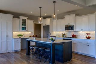 The Irving 2 Story. Kitchen. Pictures are of Model, Not Actual Home. Pictures May Feature Upgrades. Please Contact Listing Agent for Stage of Construction, Upgrades, and Available Buyer Selections.