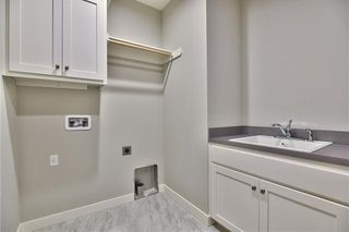 The Sonoma Reverse - Laundry Room with Built-in Upper Cabinet and Utility Sink