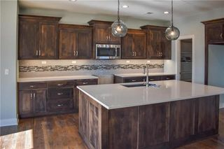 The Durham - 2 Story. Kitchen. Pictures are of Previous Spec, Not Actual Home. Pictures May Feature Upgrades. Please Contact Listing Agent for Stage of Construction, Upgrades, and Available Buyer Selections.