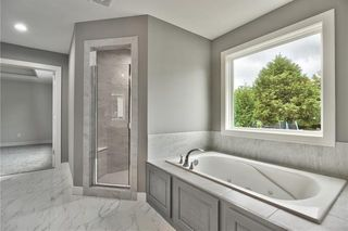 Master Bath with Double Vanity, Walk in Shower & Soaker Tub.