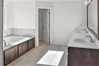 The Durham - 2 Story. Master Bathroom. Pictures are of Previous Spec, Not Actual Home. Pictures May Feature Upgrades. Please Contact Listing Agent for Stage of Construction, Upgrades, and Available Buyer Selections.