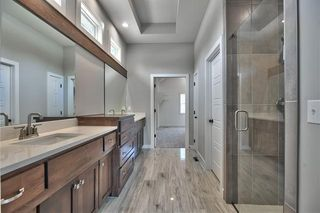 The Sonoma Reverse - Master Bathroom with Upgraded Polished Tile, Dual Vanities and Zero Entry Shower with Dual Shower Heads