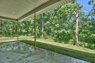 Covered Patio. I apologize for the mud. This house was just sodded and my photographer got out here before they could power wash the back patio.