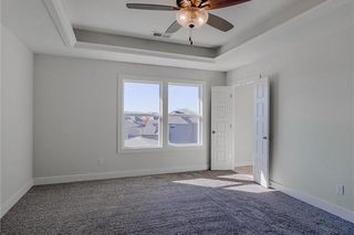 The Durham - 2 Story. Master Bedroom - Double Doors lead to Master Bathroom. Pictures are of Previous Spec, Not Actual Home. Pictures May Feature Upgrades. Please Contact Listing Agent for Stage of Construction, Upgrades, and Available Buyer Selections.