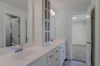 The Durham - 2 Story. Bedroom 2 connects to Bedroom 3 via a Hollywood Bath. Both Rooms have Walk In Closets. Pictures are of Previous Spec, Not Actual Home. Pictures May Feature Upgrades. Please Contact Listing Agent for Stage of Construction, Upgrades, and Available Buyer Selections.