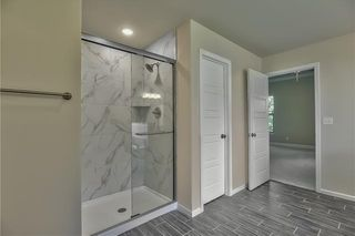 Master Bathroom with HIS & HER Vanity, Garden Soaker Tub and Tiled Walk In Shower. Picture is of Actual Home.