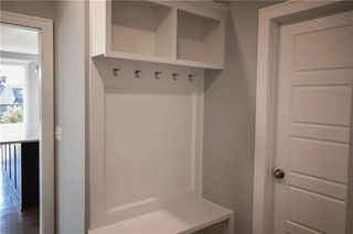 The Durham - 2 Story. Boot Bench with Upper & Lower Cubbies. Entrance to Pantry. Pictures are of Previous Spec, Not Actual Home. Pictures May Feature Upgrades. Please Contact Listing Agent for Stage of Construction, Upgrades, and Available Buyer Selections.