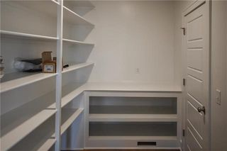 The Durham - 2 Story. Pantry. Pictures are of Previous Spec, Not Actual Home. Pictures May Feature Upgrades. Please Contact Listing Agent for Stage of Construction, Upgrades, and Available Buyer Selections.