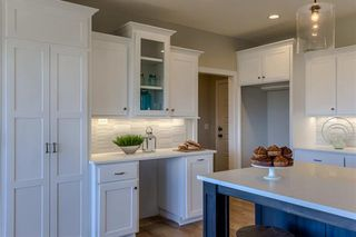 The Irving 2 Story. Double Doors lead to Extra Large Walk In Pantry. Built in Hutch. Pictures are of Model, Not Actual Home. Pictures May Feature Upgrades. Please Contact Listing Agent for Stage of Construction, Upgrades, and Available Buyer Selections.