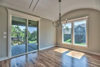 The Sonoma Reverse - Dining Room with Barrel Vault Ceiling and View to Upgraded Composite Deck