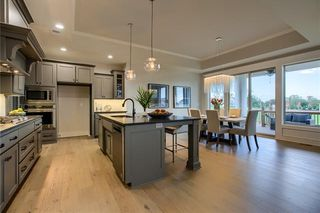 Kitchen & Dining Room. Pictures are of Model and May Feature Upgrades. Not Actual Home.