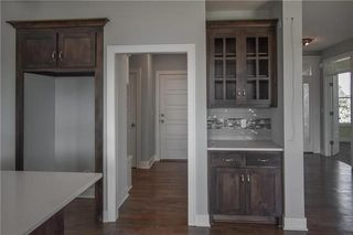 The Durham - 2 Story. Mud Room/Interior Garage Entrance. Pictures are of Previous Spec, Not Actual Home. Pictures May Feature Upgrades. Please Contact Listing Agent for Stage of Construction, Upgrades, and Available Buyer Selections.