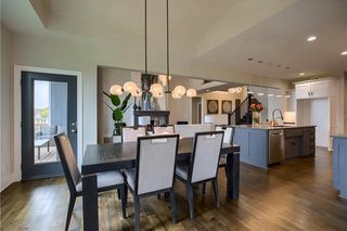 The New Haven 1.5 Story. Dining Room. Pictures are of Previous Model, Not Actual Home. Pictures May Feature Upgrades. Please Contact Listing Agent for Stage of Construction, Upgrades, and Available Buyer Selections.