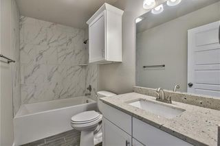 3rd Bathroom. Comfort Height Elongated Toilet, Tile Floor, Granite Counter Tops, Tile Surround Tub/Shower. Picture is of Actual Home.