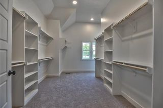 The Sonoma Reverse - Master Bedroom Closet with Built-in Shelving