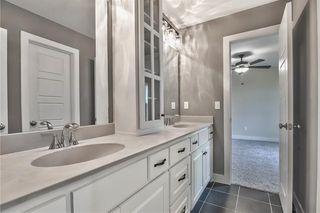 Hollywood Bath with Double Vanity between Bedroom #3 & Bedroom #4.