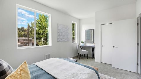 The Second Bedroom with Desk at the Wren at the Flatiron Station in Hillman City by Sage Homes Northwest