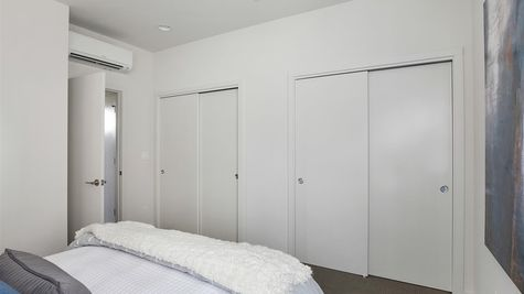 Master Bedroom and Closets at the Maya at the Flatiron Station in Hillman City by Sage Homes Northwest