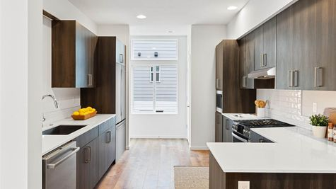 Kitchen of the Fuller at Post Square Townhomes in Hillman City by Sage Homes Northwest