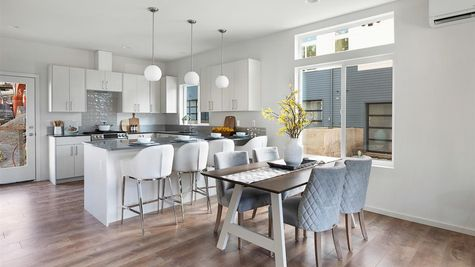 The Kitchen and Dining Room at the Wren at the Flatiron Station in Hillman City by Sage Homes Northwest