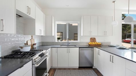 The Kitchen Appliances at the Wren at the Flatiron Station in Hillman City by Sage Homes Northwest