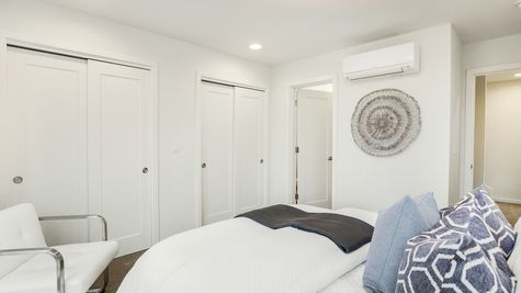The Foster Guest Bedroom, Bathroom, and Hallway by Sage Homes Northwest