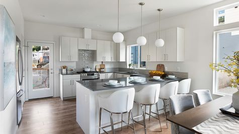 The Kitchen and Kitchen Lighting at the Wren at the Flatiron Station in Hillman City by Sage Homes Northwest