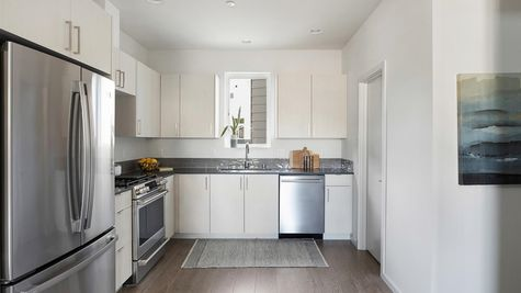 Kitchen at the Maya at the Flatiron Station in Hillman City by Sage Homes Northwest
