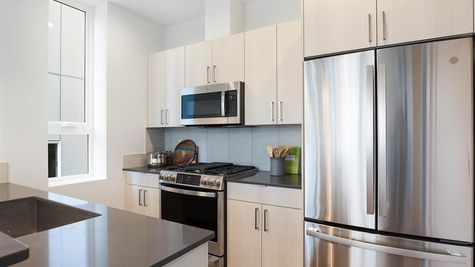 Kitchen Appliances of the Sullivan Townhome at 212A 17th Ave E by Sage Homes Northwest