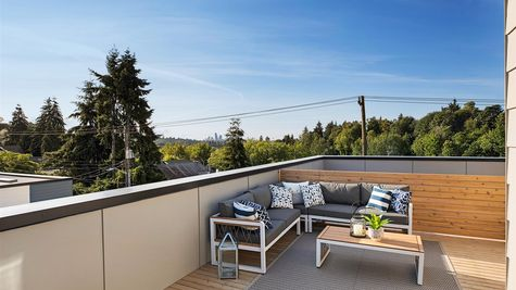 The Roof Deck and View of Downtown Seattle at the Wren at the Flatiron Station in Hillman City by Sage Homes Northwest