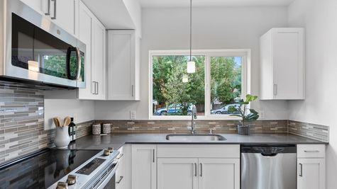 Kitchen with view of the Alvar by Sage Homes Northwest