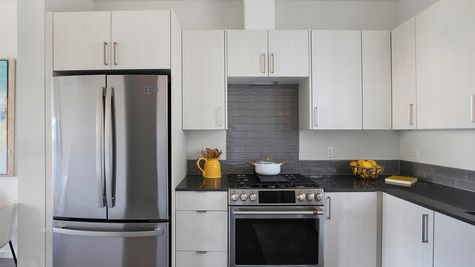 Kitchen Backsplash at the Maya at the Flatiron Station in Hillman City by Sage Homes Northwest