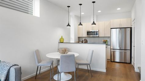 Kitchen and Dining of the Sullivan Townhome at 212A 17th Ave E by Sage Homes Northwest