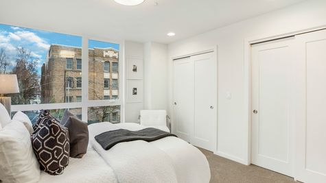 The Foster Guest Bedroom, Picture Windows, and Closets at 214 17th Ave E by Sage Homes Northwest