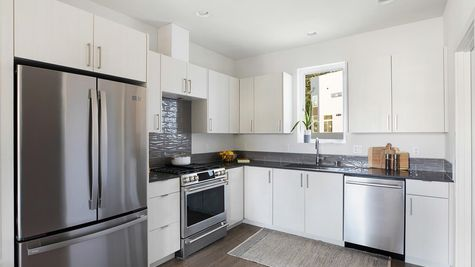 Kitchen Appliances at the Maya at the Flatiron Station in Hillman City by Sage Homes Northwest