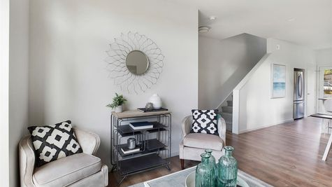 Living Room and Entry at the Wren at the Flatiron Station in Hillman City by Sage Homes Northwest