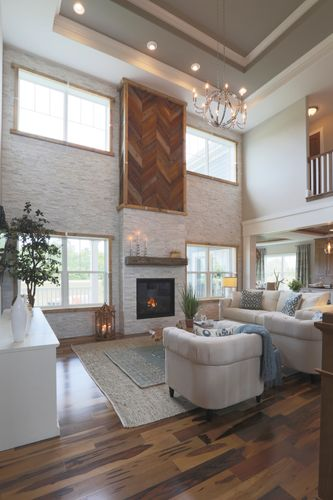Two-story hearth room in a new home by Tim O'Brien