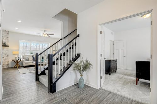 Straight staircase and living room in a Tim O'Brien home