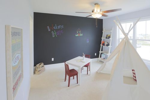 Bedroom with chalkboard wall by Wisconsin home builders