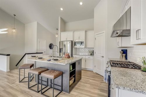 White modern kitchen by home builders in Madison WI