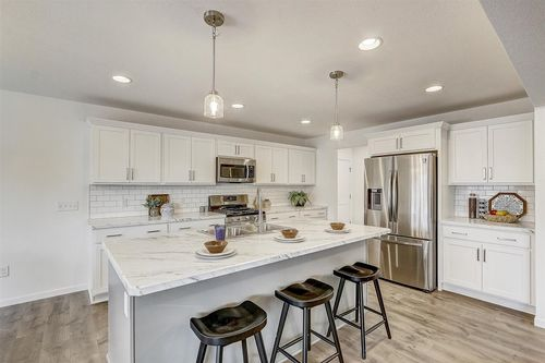 White kitchen in a new home but Tim O'Brien Homes