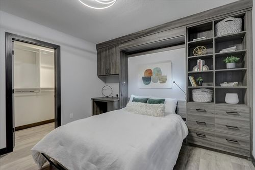 Bedroom with built-in cabinets in a new home by Tim O'Brien