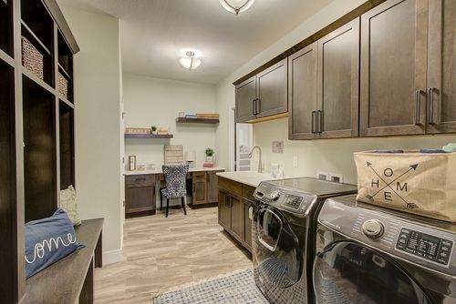 Laundry room and built-in desk in a Wisconsin model home