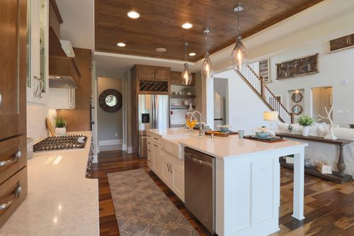 Kitchen with wood ceiling in a new home by Tim O'Brien